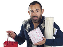 Bearded man holding a variety of wrapped gifts Royalty Free Stock Image