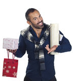 Bearded man holding a variety of wrapped gifts Stock Photography