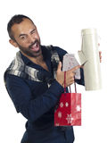 Bearded man holding a variety of wrapped gifts Royalty Free Stock Photography