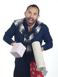 Bearded man holding a variety of wrapped gifts Stock Photos