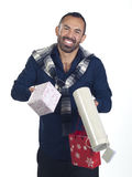 Bearded man holding a variety of wrapped gifts Stock Image