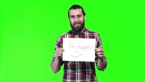 Bearded man holds up happy sign stock video footage