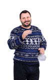 Bearded man holds a vodka shot. Bearded middle aged man holds a vodka shot in his right hand Stock Photo