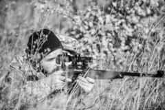 Bearded man hunter. Military uniform fashion. Army forces. Camouflage. Hunting skills and weapon equipment. How turn. Hunting into hobby. Man hunter with rifle royalty free stock photo