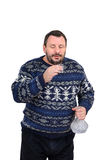 Bearded man intends to drink vodka shot. Fifty years man in a sweater man intends to drink vodka shot Royalty Free Stock Photos