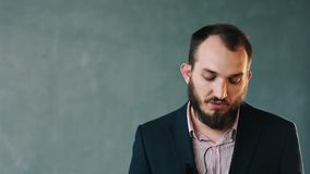 Bearded man in jacket and striped shirt expertly talk about camera lense stock video