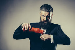 Bearded man with ketchup bottle Royalty Free Stock Photos