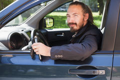Bearded man with keys as a driver of modern suv Royalty Free Stock Images