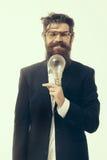 Bearded man with lamp as einstein formula symbol Royalty Free Stock Photos