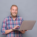 Bearded man with laptop Stock Image