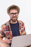 Bearded man with laptop Stock Images