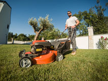 Bearded man with a lawnmower Stock Photos