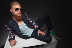 Bearded man laying on a studio table Stock Image