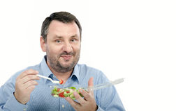 Bearded man likes takeaway salad Royalty Free Stock Photo