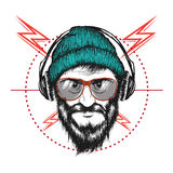 Bearded man listening a music in headphones Stock Images