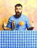 Brutal caucasian hipster with tropical alcohol fresh cocktail. Bearded man, long beard. Brutal caucasian surprised hipster with moustache in denim shirt with royalty free stock photos