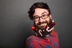 Bearded man with long lush beard and christmas tree toys Stock Photography