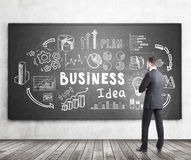 Bearded man looking at business idea Stock Image