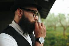 Bearded man looks into the distance Stock Photos