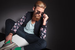 Bearded man looks over his glasses Stock Photography