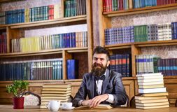 Bearded man with lots of books stock photography