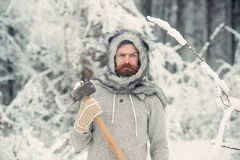 Bearded man lumberjack hold axe in snowy winter forest, camping. Bearded man lumberjack hold axe in snowy winter forest at christmas holiday, winter sport and stock image
