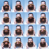 Bearded man with magnifying glass Royalty Free Stock Images