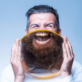 Bearded man with magnifying glass Royalty Free Stock Photography
