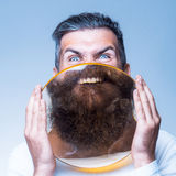 Bearded man with magnifying glass Royalty Free Stock Image