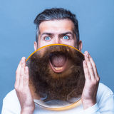 Bearded man with magnifying glass Stock Photos