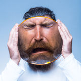 Bearded man with magnifying glass Royalty Free Stock Photos