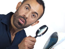 Bearded man with map and magnifying glass Royalty Free Stock Image