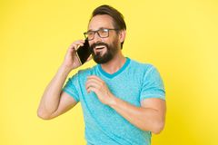 Bearded man. Mature hipster with beard. Facial care. Male fashion. brutal caucasian hipster with moustache. happy man. Speaking on phone. pleasant conversation royalty free stock photo