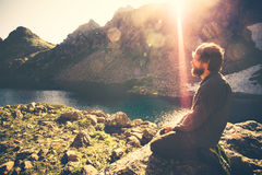 Bearded Man meditating relaxing alone Travel healthy Lifestyle concept Stock Images