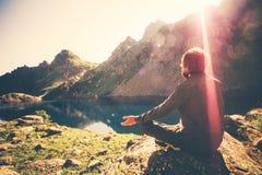 Bearded Man meditating yoga relaxing alone sitting lotus pose on stone Travel healthy Lifestyle Stock Image