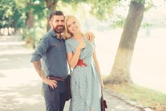 Bearded man meet his girlfriend after work. royalty free stock photos