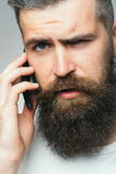 Bearded man with mobile phone Stock Images