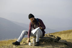 Bearded man on mountain top Stock Photos