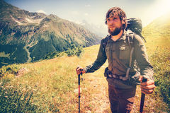Bearded Man mountaineering with backpack. Travel Lifestyle concept mountains on background Summer active vacations outdoor sunny day royalty free stock photo