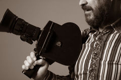 Bearded Man Movie Camera thoughtfully looks Royalty Free Stock Photos