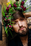 Bearded man with nice bouquet of flowers on his head. Handsome bearded man with nice bouquet of flowers on his head Stock Photos