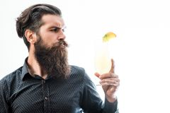 Bearded man with nonalcoholic cocktail. Handsome bearded man with stylish hair mustache and beard on serious face holding glass of nonalcoholic cocktail isolated Stock Image