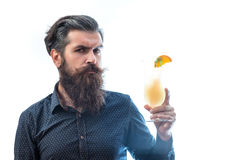 Bearded man with nonalcoholic cocktail. Handsome bearded man with stylish hair mustache and beard on serious face holding glass of nonalcoholic cocktail isolated Stock Photos