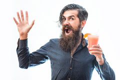 Bearded man with nonalcoholic cocktail. Handsome bearded man with stylish hair mustache and long beard on happy face holding glass of nonalcoholic cocktail Stock Photos