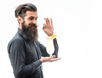 Bearded man with nonalcoholic cocktail. Handsome bearded man with stylish hair mustache and long beard on satisfied face holding glass of nonalcoholic cocktail Stock Photo