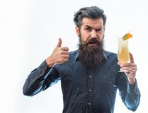 Bearded man with nonalcoholic cocktail. Handsome bearded man with stylish hair mustache and long beard on satisfied face holding glass of nonalcoholic cocktail Royalty Free Stock Image