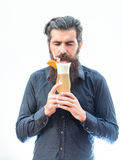 Bearded man with nonalcoholic cocktail. Handsome bearded man with stylish hair mustache and long beard on satisfied face holding glass of nonalcoholic cocktail Royalty Free Stock Photo