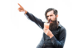Bearded man with nonalcoholic cocktail. Handsome bearded man with stylish hair mustache and long beard on satisfied face holding glass of nonalcoholic cocktail Stock Photos