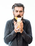 Bearded man with nonalcoholic cocktail. Handsome bearded man with stylish hair mustache and long beard on satisfied face holding glass of nonalcoholic cocktail Royalty Free Stock Photography
