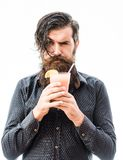 Bearded man with nonalcoholic cocktail. Handsome bearded man with stylish hair mustache and long beard on serious face holding glass of nonalcoholic cocktail Stock Photos